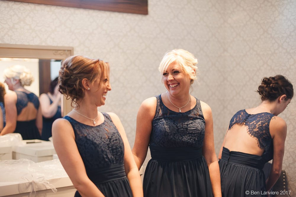 bridesmaids in navy blue dresses laughing