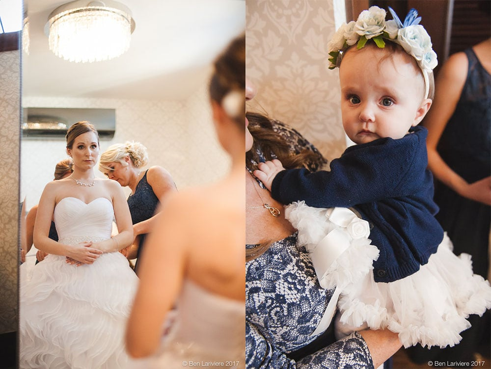 bride in front of a mirror and a baby wearing a flower crown