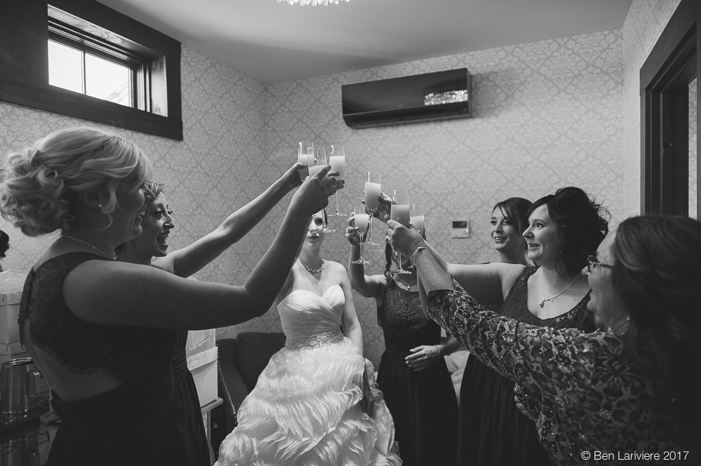 bride and bridesmaids cheersing