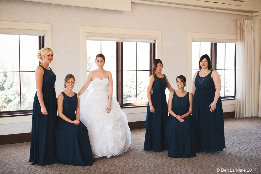 bridesmaids standing in two groups