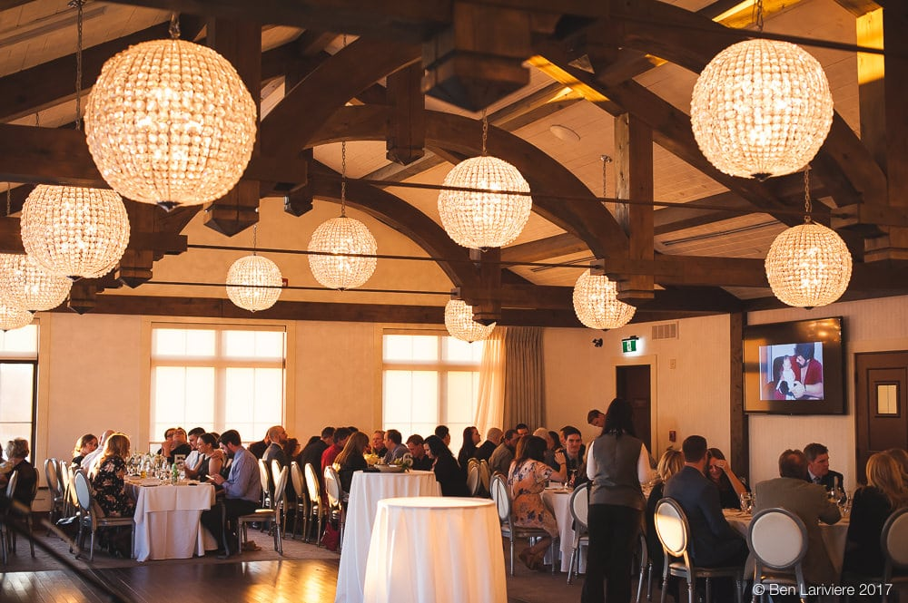spherical chandeliers hang in wedding reception space at whistle bear golf club