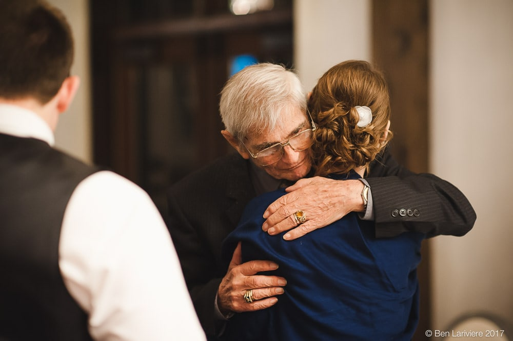 grandfather hugging bride