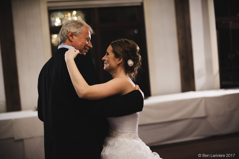 bride and her father laugh during formal dance