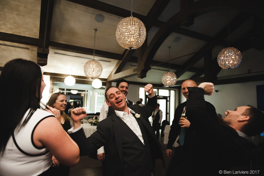 guests laugh while dancing at wedding reception