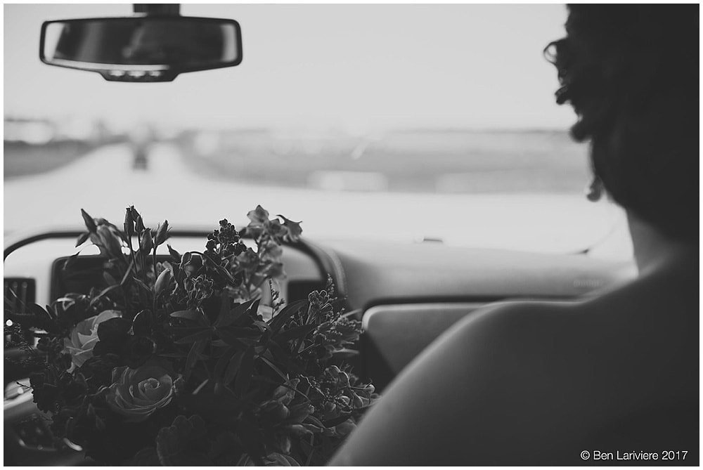 bridal bouquet on the dashboard of a truck