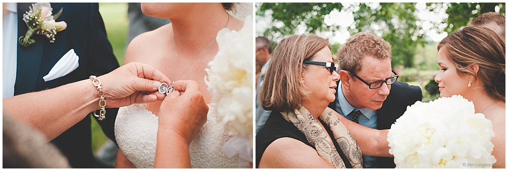family members look at bride's locket necklace
