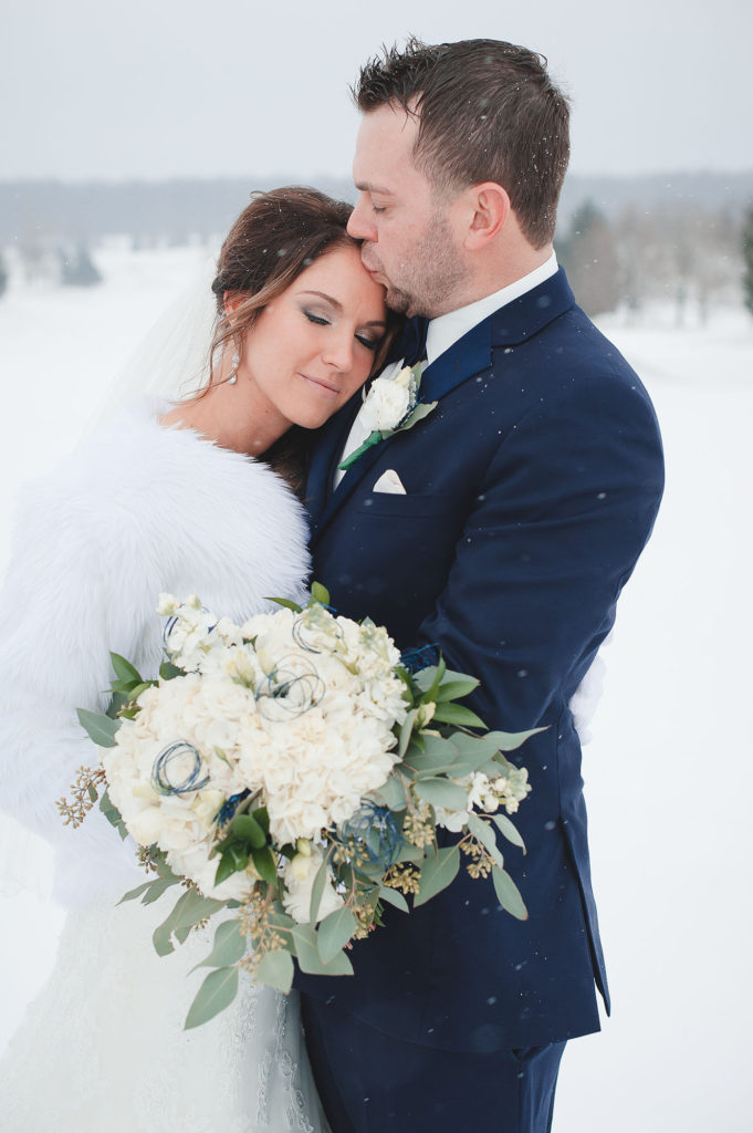 Dana & Joe Voll winter snow bride and groom wedding