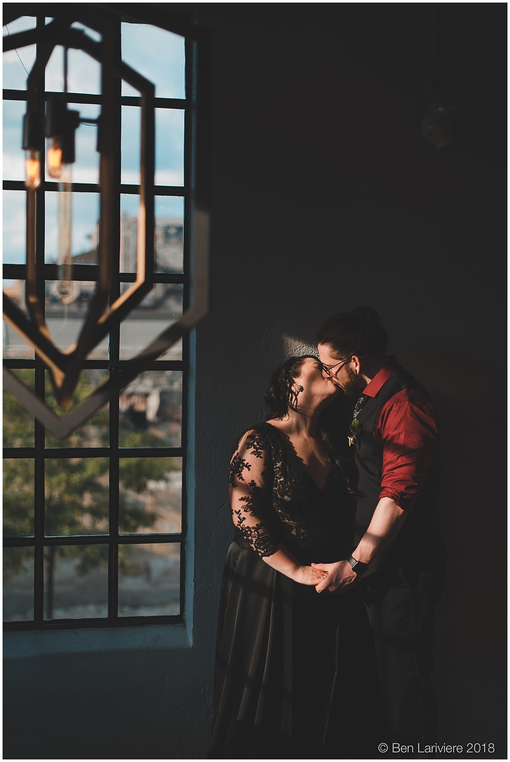 bride and groom kiss in dramatic light at EVO Kitchen cambridge