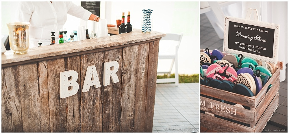 tent wedding reception barn board bar and flip flops