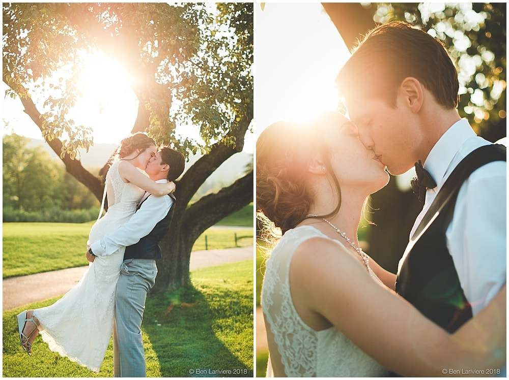 bride and groom romantic kiss by tree at sunset with lens flare