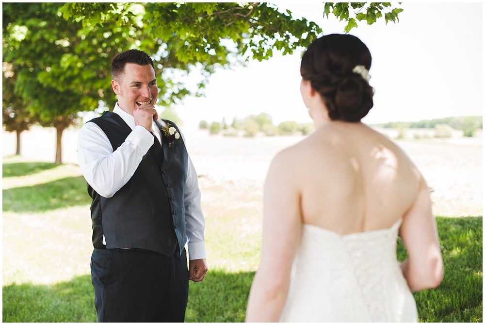 groom bites fist upin seeing bride during first look