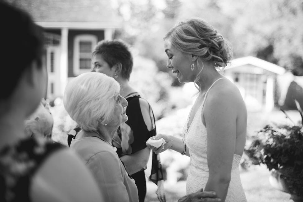 bride shares an emotional moment with a family member