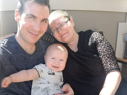 Ben Lariviere with his wife and young son