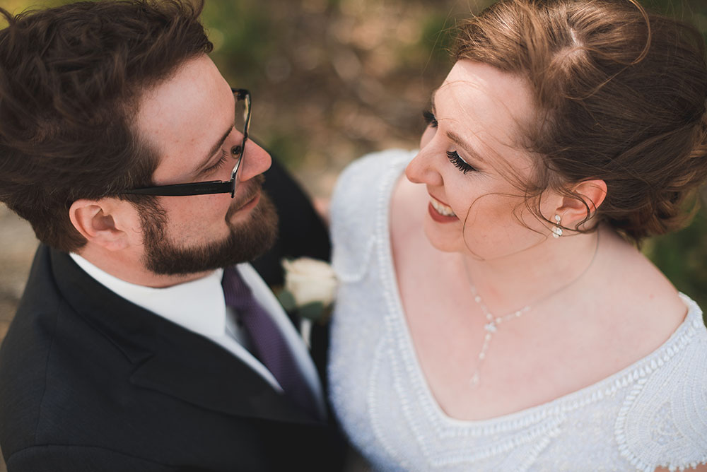 high-angle shot of bride and groom smiling at each other