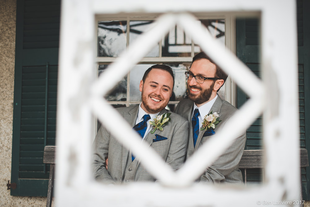 toronto same sex wedding couple framed by white architectural feature