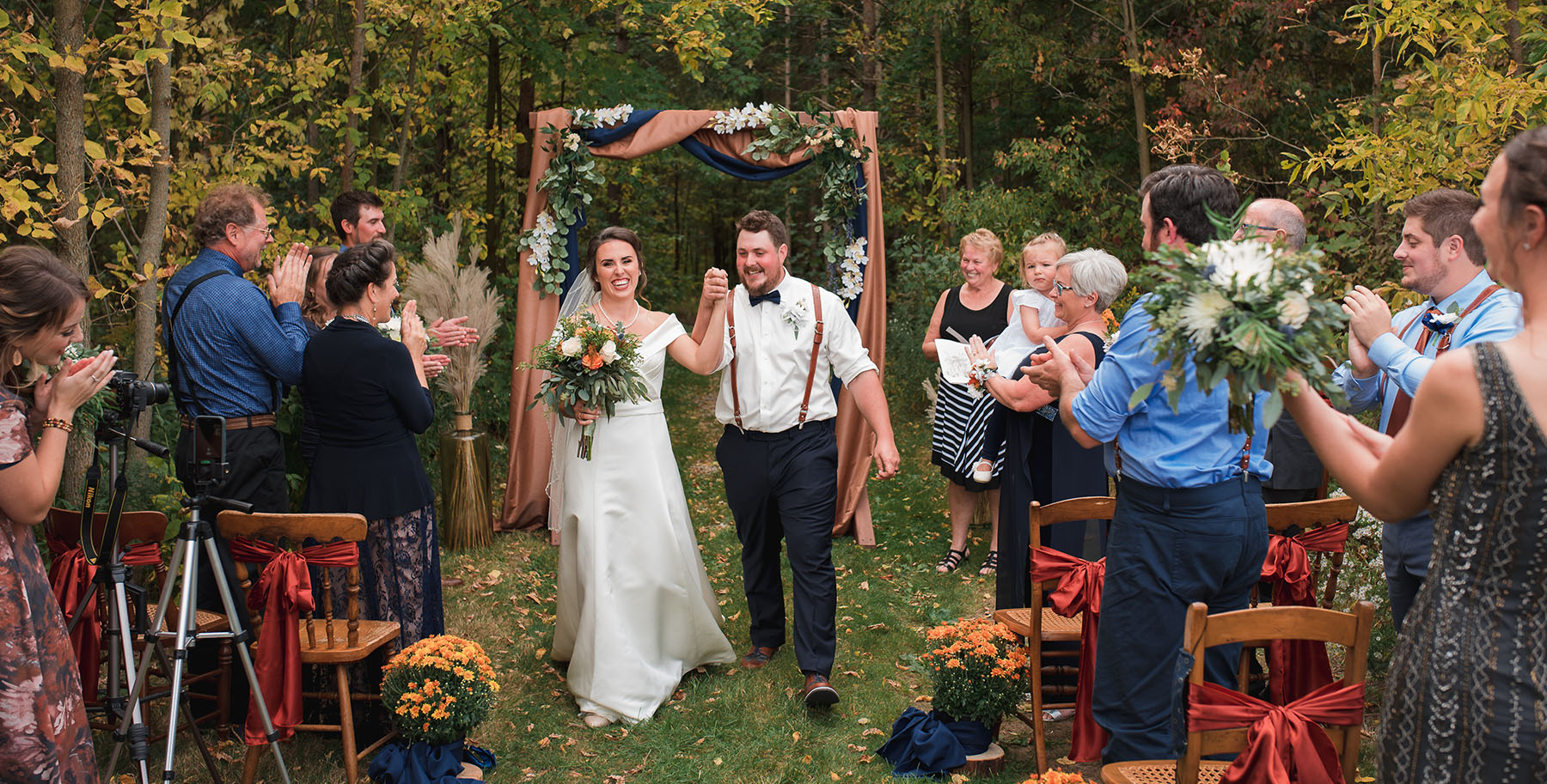 bride and groom smiling during intimate wedding ceremony recessional