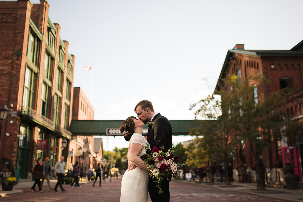 bride and groom kissing in Toronto's distillery district
